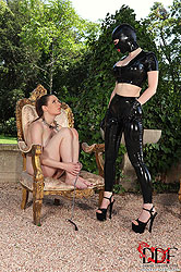 Latex Lucy Plugs Slave's Ass