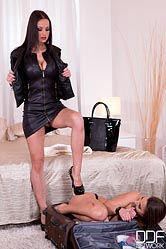 Hotel femdom brunette sub gets anal stuffed with black dildo.